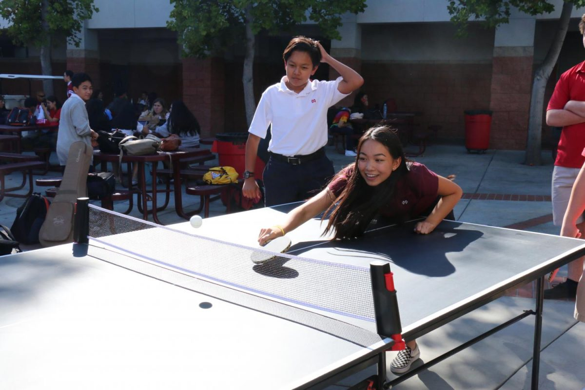 Freshman Teresa Bui plays a competitive game of Ping Pong against her friends.