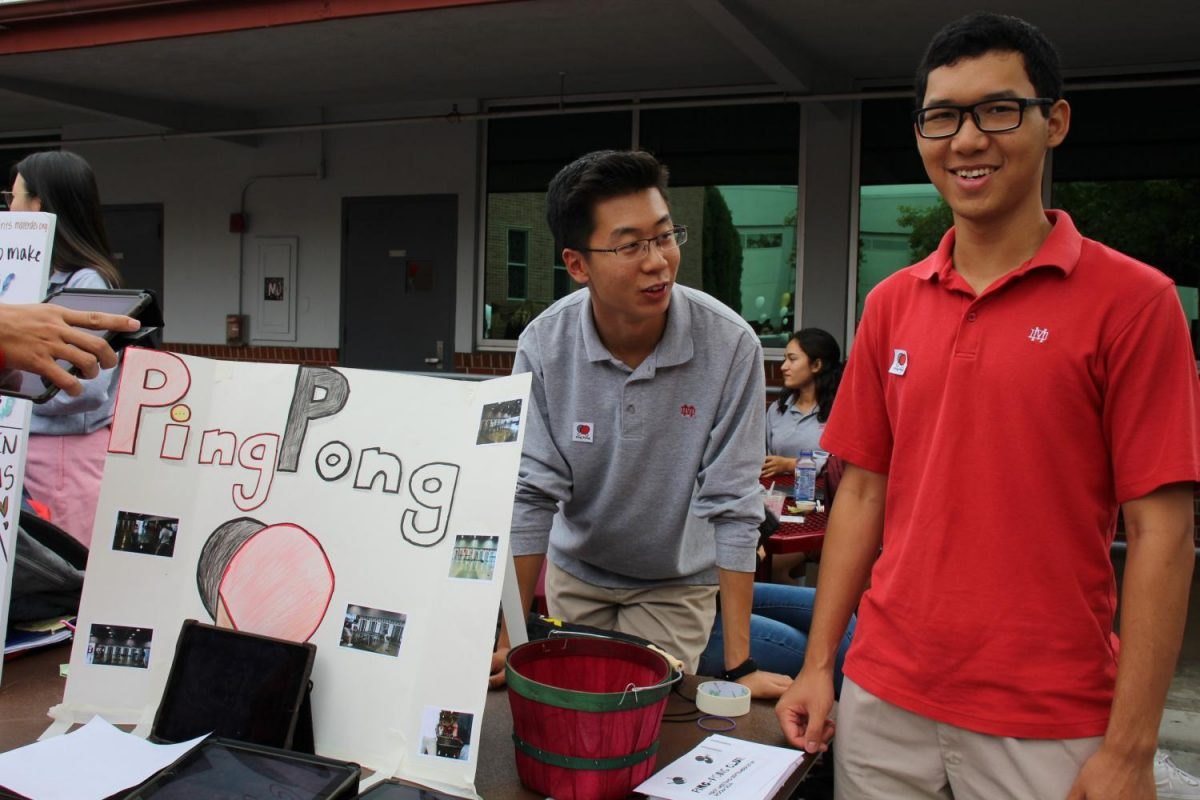 Seniors Tuan Do, president of Ping Pong Club, and Vice President Jarvis Yuan recruit interested students at the annual Club Fair, which was held on September 20.