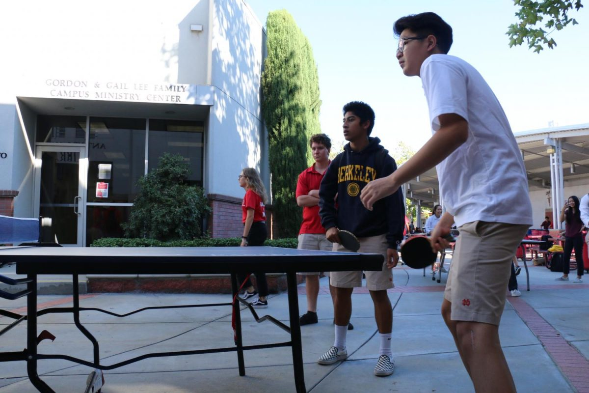 Senior Charlie Chen plays an intense game of Ping Pong as a returning player and member outside the LeVecke Center. The club often meets inside or outside the LeVecke Center.
