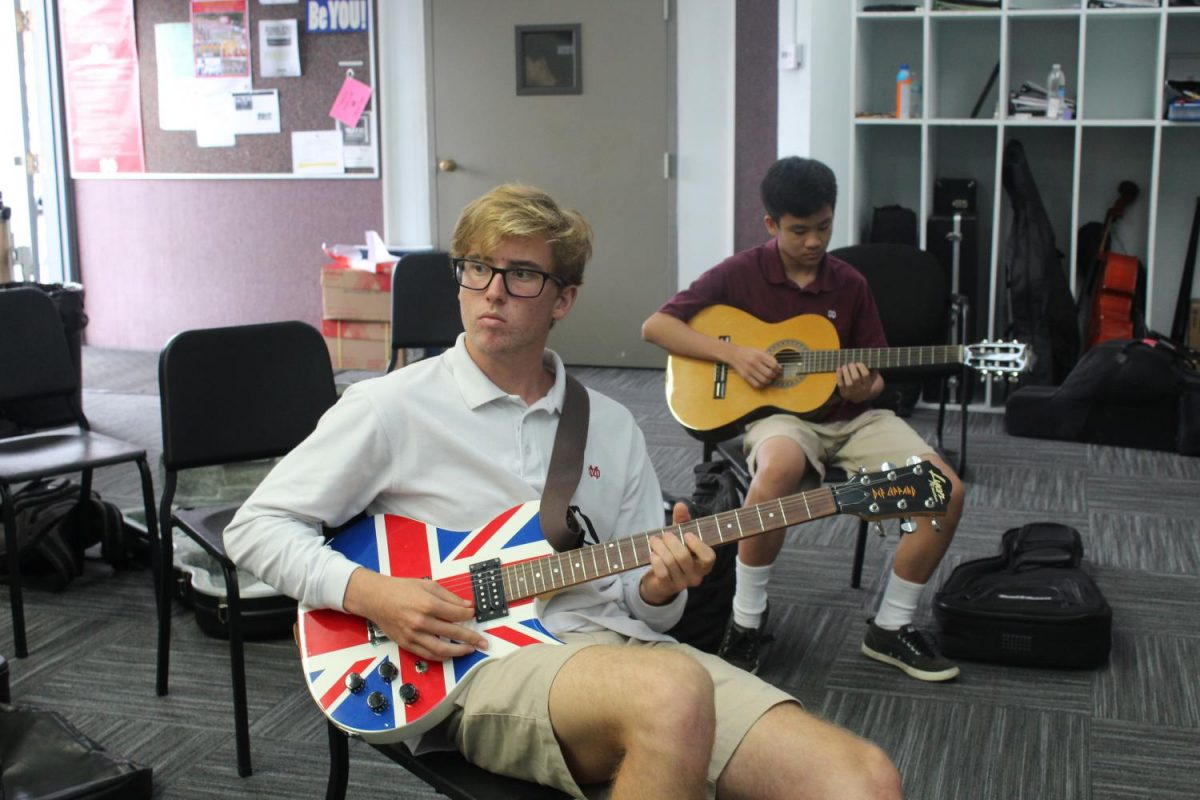 Senior Jake Armstrong practices improvisation and theory in the advanced guitar class.