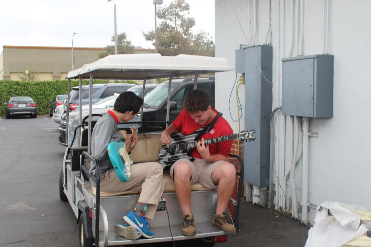 Two advanced players practice for their upcoming performance outside of the band room.