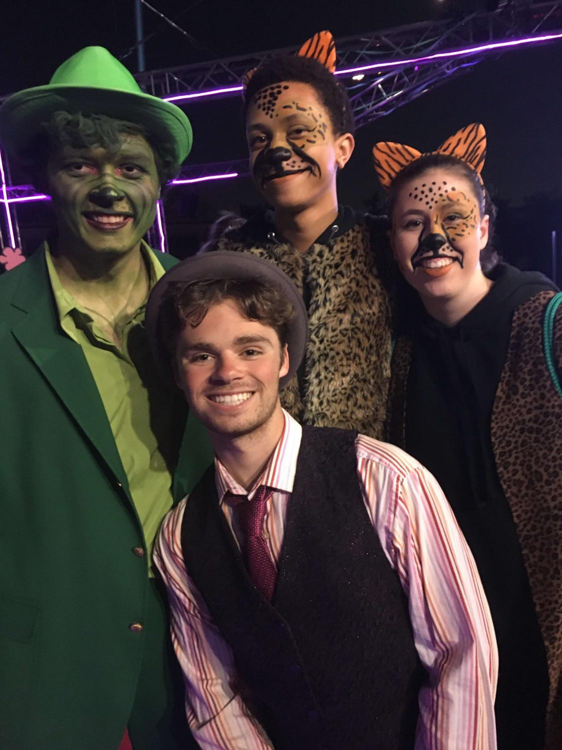 (Left to Right) Seniors Aiden Mulholland, Jagari Jennings, Jack Chorbagian and Michaela Maguin pose after a performance.
