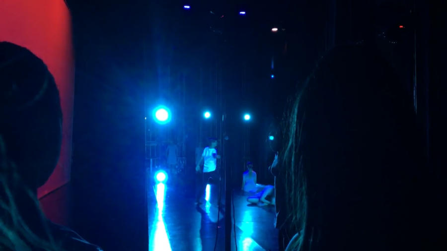 Dancers watch from the curtain sides as their peers wow the audience with their performance of
