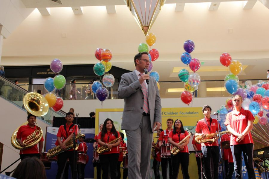 INTRODUCTION: Performing Arts Director Scott Melvin introduces Mater Dei's student performers at the Festival of Children on Sept. 16.