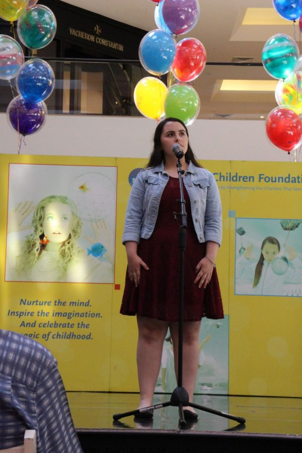 CUTTING LOUD AND CLEAR: Sophomore Maureen Beld sings