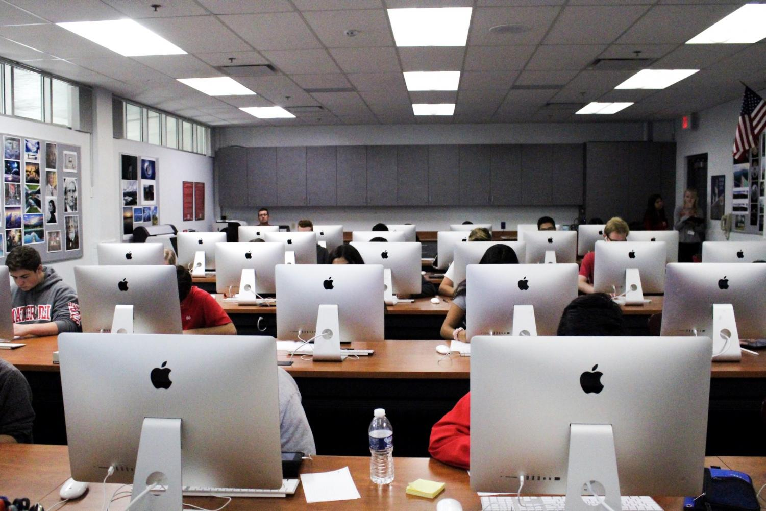 DIGITAL LEARNING: Students in Kyle Roberts' block 4 Contemporary Media class in room 103 work on iMacs on Sept. 7.