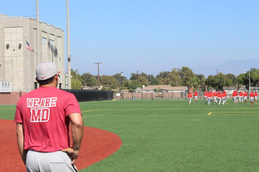 TIGHT SHIFT: New baseball coach Richard Mercado makes the frosh-soph team run together in consequence of a poor performance on the field. Even in the toughest times, Mercado's biggest objective is that everything the teams do is done together.