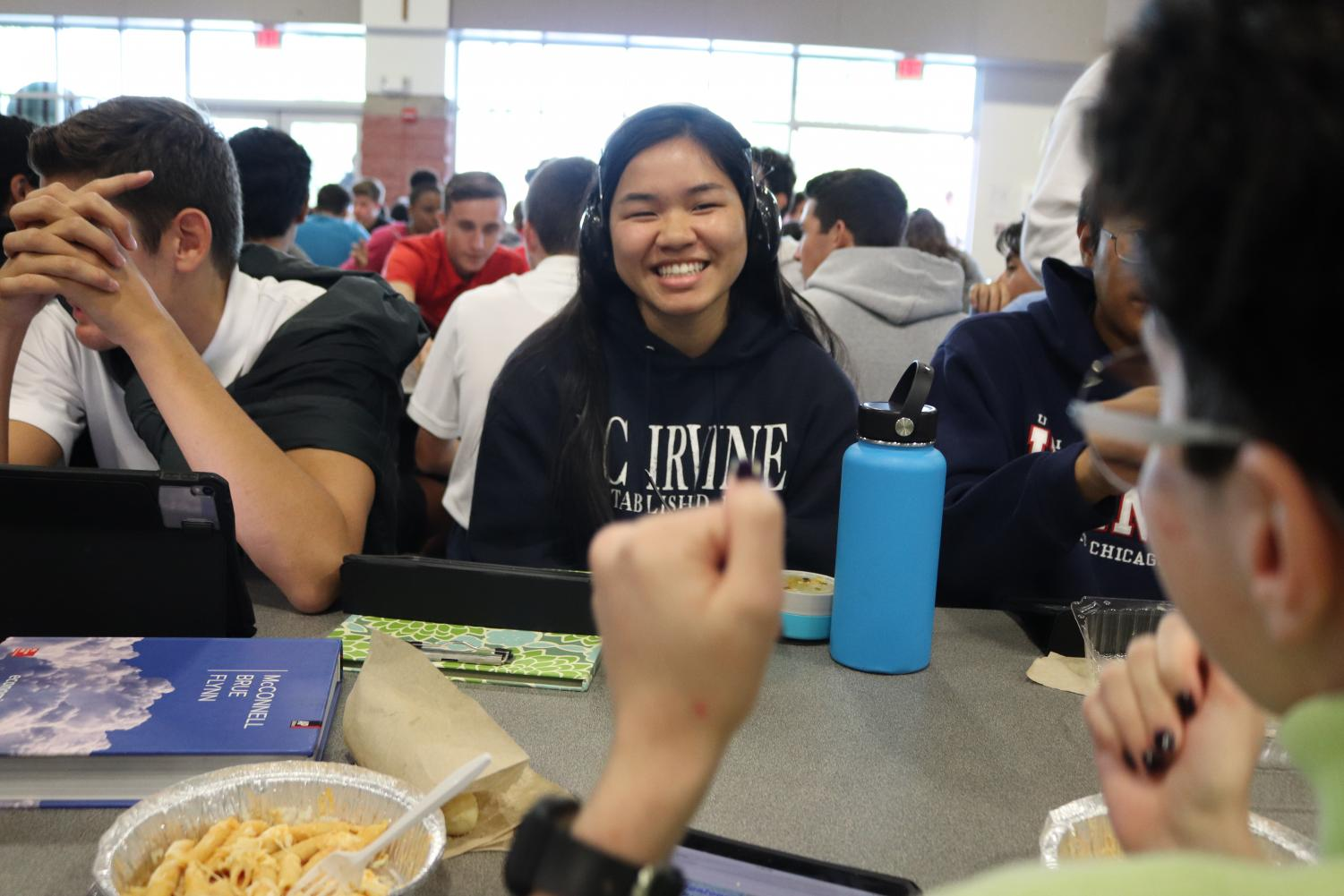 SILLY SMILES: Senior Maithu Tran laughs as a friend sitting across from her - senior Claire LaFont - demonstrates a silly dance while at lunch in the LeVecke Center. Tran was one of the 11 ASL IV students to participate in the Deaf for a Day experience on Oct. 3.