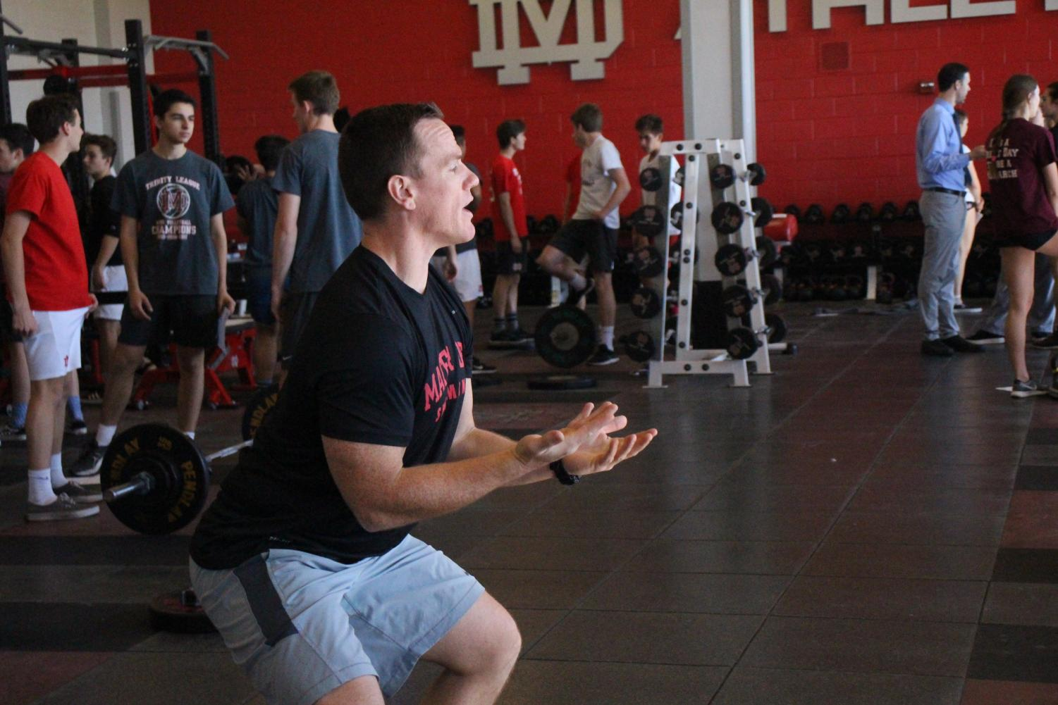 LEADING+THE+WAY%3A+Assistant+strength+and+conditioning+coach+Bubba+Reynolds+instructs+the+girls+volleyball+team+on+the+proper+form+for+their+workout.+Reynolds+helps+coach+many+teams+during+the+many+weight+lifting+blocks.+%22I+always+think+strength+and+conditioning+is+all+like+swim+lessons%2C+so+if+you+can%E2%80%99t+tread+water+I%E2%80%99m+not+going+to+have+you+go+into+the+deep+end.%22+Reynolds+said%2C+%22So+it%27s+just+as+you+guys+continue+to+take+on+new+skills+then+we+can+continue+to+work+on+more+complex+skills.%22%0A%0A%0A%0A%0A%0A%0A%0A%0A%0A%0A%0A%0A