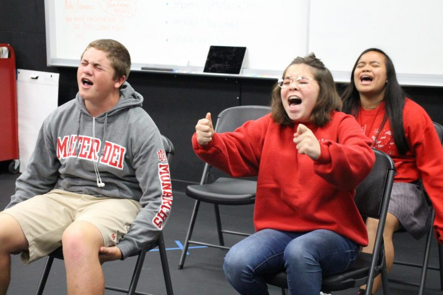 SINGING STUDENTS: While performing improvised scenes in front of their peers, students from Andrea Fouts' Block 4 class make fun of celebrities and stereotypes. Practicing improvised scenes is one of many different exercises that Fouts has incorporated into her new theatre classes.