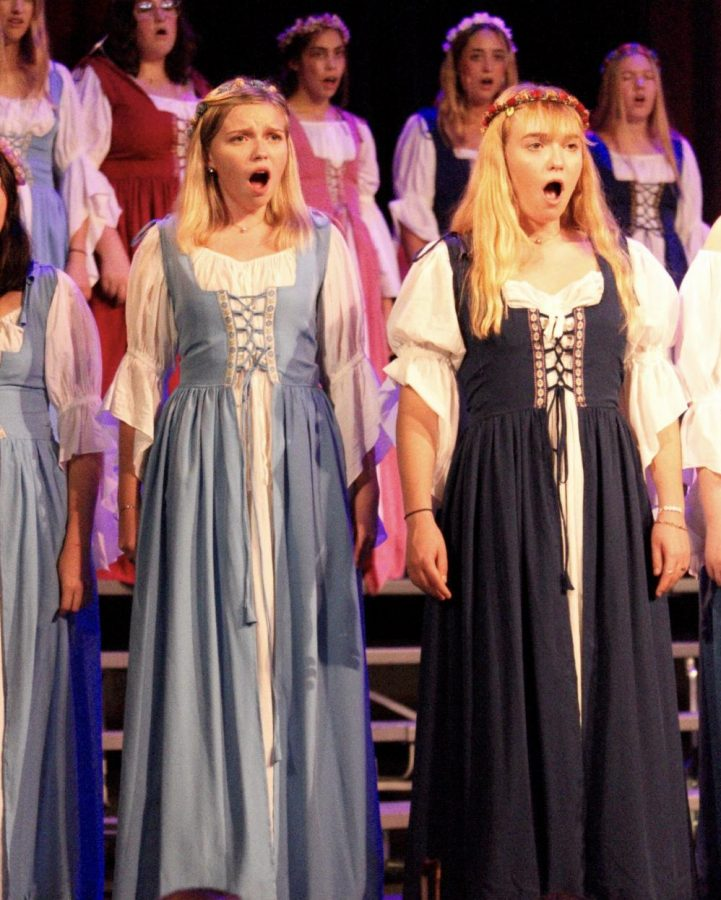 SOUNDS OF MUSIC: Sophomore Bel Canto Singers Reese Wineroth and Jacqueline Kerr perform during the Madrigal Feast dress rehearsal on Dec. 6. This year is the program's 29th show.