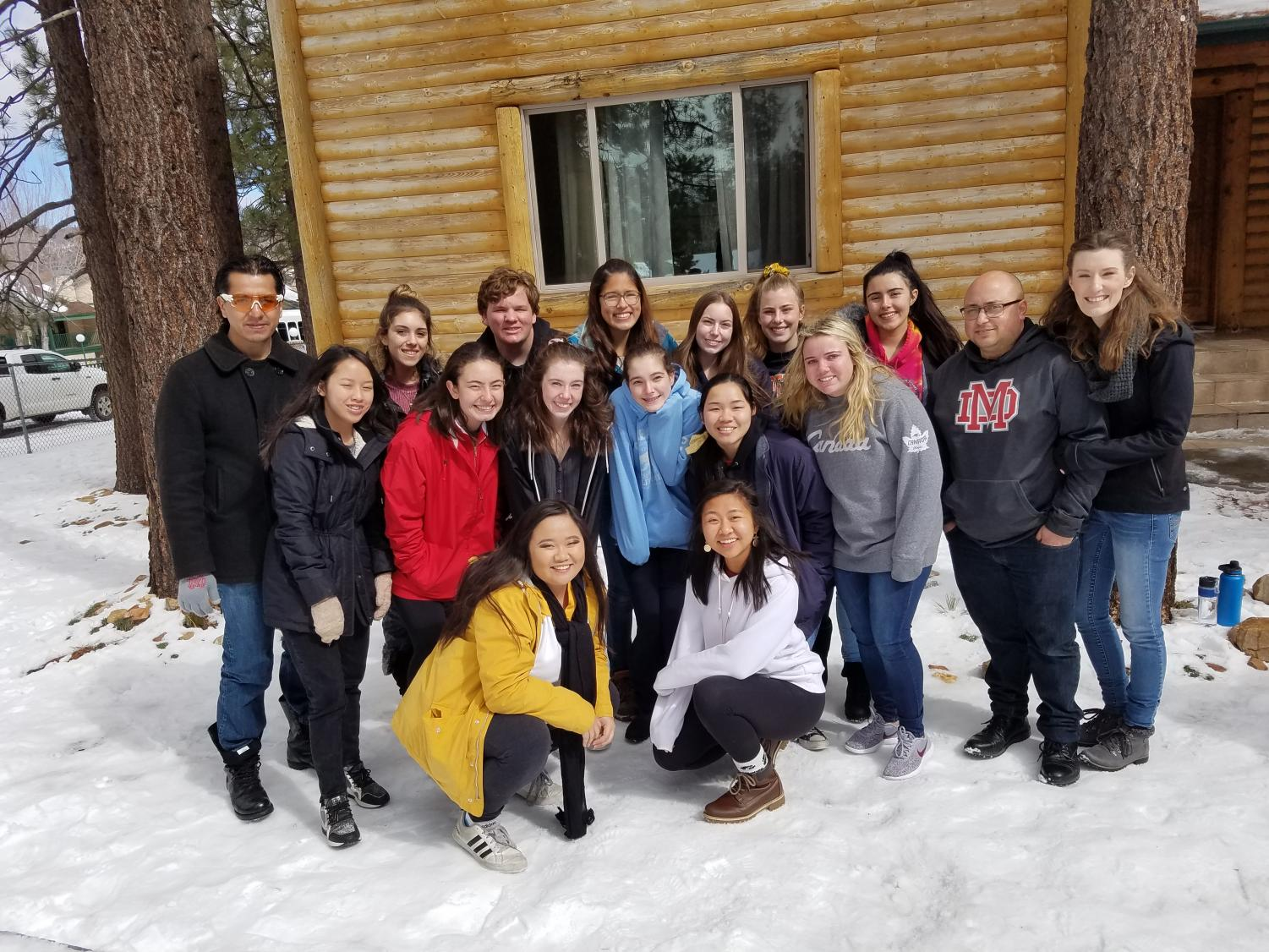 SMILES ALL AROUND: Mater Dei students pose in front of their cabin.