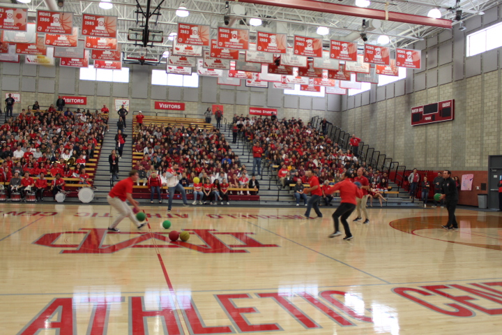 DODGEBALL+SHENANIGANS%3A+One+of+the+games+that+athletes+and+coaches+were+able+to+participate+in+was+a+game+of+dodgeball.+Coaches+teamed+up+in+one+side+of+the+court+their+athletics+on+the+other+and+the+battle+to+be+the+last+person+standing+began.+The+game+ended+with+multiple+people+making+it+to+the+end+and+no+singular+winner.+Students+in+the+crowd+were+able+to+cheer+on+their+teammates+and+coaches.