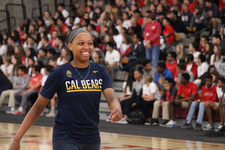 SENIOR+SMILES%3A+Senior+Cailyn+Crocker+crosses+the+Meruelo+floor+as+her+name+is+called%3B+Crocker+is+on+the+Varsity+Girls%27+Basketball+Team+will+be+attending+Cal+Berkeley+next+fall.