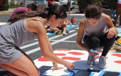Seniors paint personal parking spots as part of a new ASB fundraiser