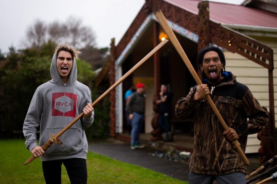 BATTLE PREP: At the meeting house in Hokianga, sophomore Max Shaw practices his battle face with a local on July 12.
