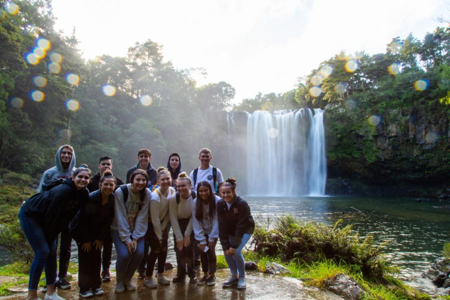 FALLING+FOR+THIS+VIEW%3A+Students+pose+for+a+group+photo+while+observing+Rainbow+Falls+in+Hokianga%2C+New+Zealand+on+July+11.+%E2%80%9CI+don%E2%80%99t+think+any+kid+was+sad+about+going+to+the+strip%2C%E2%80%9D+Marsh+said.+%E2%80%9CI+thought+maybe+for+a+moment+15+days+was+going+to+be+too+long+and+they+would+get+homesick+but+everyone+sad+to+leave+and+it+didn%E2%80%99t+feel+long+enough.%E2%80%9D
