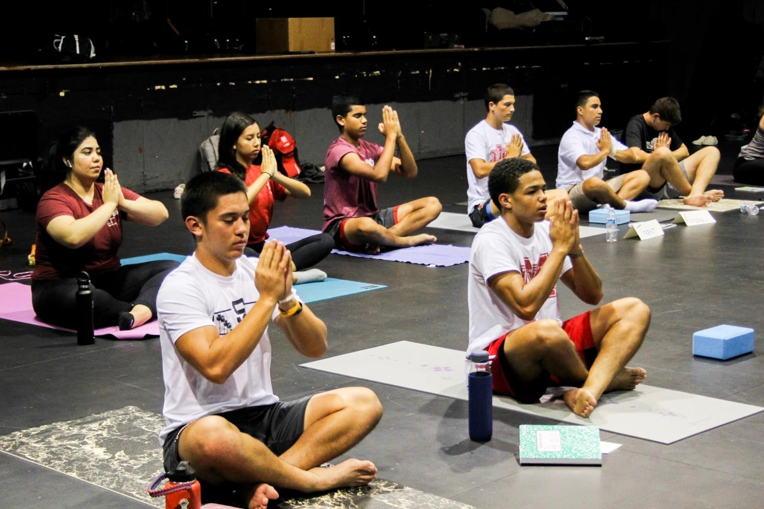 NAMASTE%3A+Sophomore+Joshua+Hunter+and+junior+Josiah+Zamora+practice+traditional+yoga+poses+in+class.+The+class+emphasizes+mental+wellness+and+inner+peace.+%E2%80%9C...every+time+we+finish+practicing+yoga%2C+we+end+with+eight+minutes+of+dead+silence%2C+no+movement%2C+to+reconnect+with+your+breath+and+relax+and+take+in+everything%2C%22+senior+Jeffrey+Peterson+said.+%22That%27s+my+favorite+part.%22