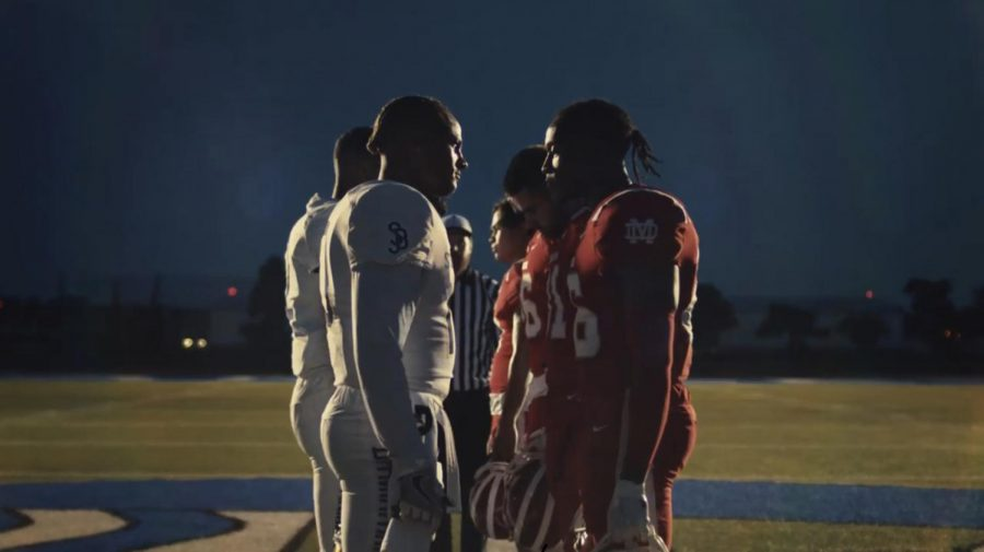 FACE OFF: Actors portraying Mater Dei's Monarch football team face off against their rivals, the St. John Bosco Braves, also portrayed by actors. The well-known rivalry was featured in Gatorade's recent commercial, which debuted this summer.