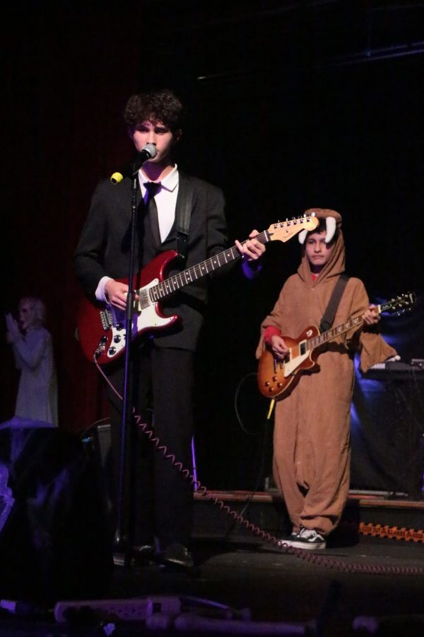 """Senior Ruben Vazquez and senior Dylan DiGennaro perform I am the Walrus by the Beatles. """"I was genuinely impressed by the quality of the scares and it was a brilliant reflection of their dedication to making it as authentically spooky as possible."""" Said DiGennaro."""