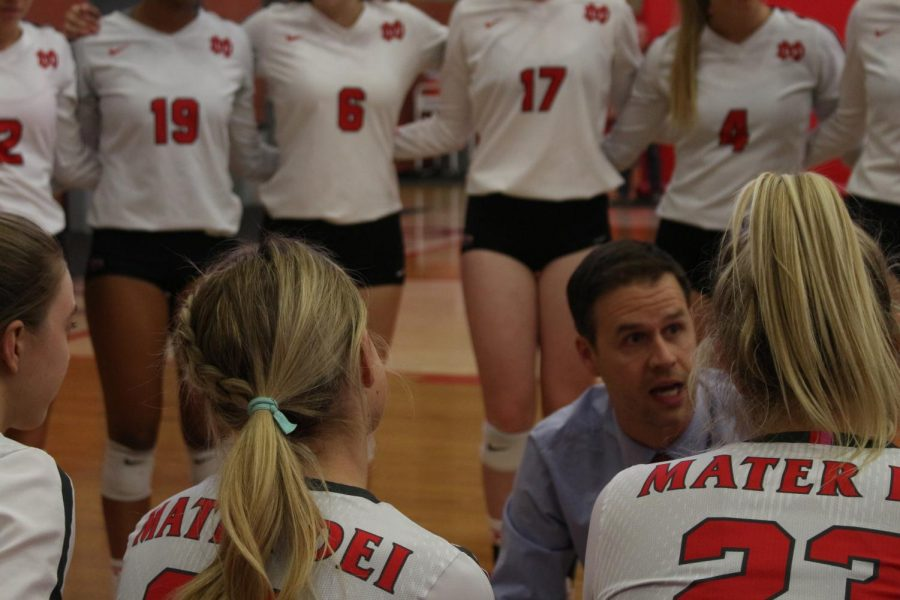 LISTEN UP: Coach Dan O'Dell speaks with the players on the girls' varsity volleyball team during their first CIF quarter final game against Mira Costa on Oct. 30. The girls defeated Mira Costa 3-0 and headed to the semi-finals against Marymount High School. The girls are currently ranked no. 5 in the nation, according to MAX Preps.