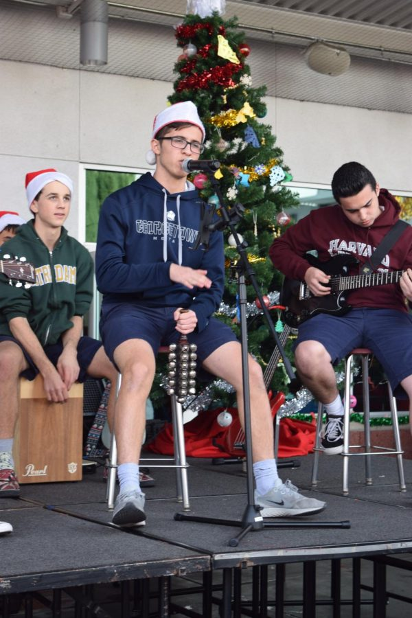 PERRY CHRISTMAS: Solorio creates a beat with bells as he sings the