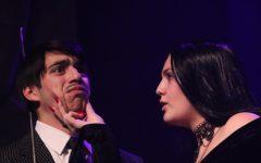 KEEP NO SECRETS Senior Stella Puzzoli grabs junior Sebastian Ledezma's face during the Addams Family Musical.