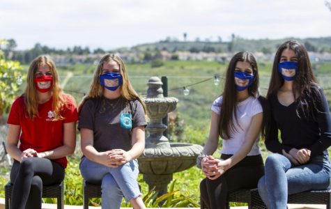 TAKING A POSITIVE STANCE (left to right): Sophomore Maggie Dietrick, eighth grader Kate Dietrick, eighth grader Izzy Dastgheib, and sophomore Hannah Dastgheib pose wearing their invention: Read My Lips Masks
