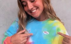"USING HER VOICE: Senior Taylor Bruder poses with her ""I Voted"" sticker after voting in the 2020 U.S. Presidential Election. Bruder posted her photo to her Instagram story to promote awareness of the election, which will take place on Nov. 3. ""I'm going to vote because I'm concerned about our country,"" Bruder said. ""People's rights are on the line. I'm voting to protect my rights and other minorities rights."""