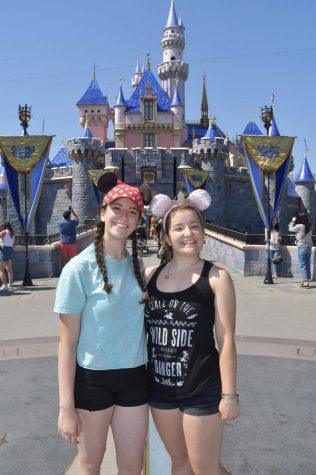 "THE HAPPIEST PLACE ON EARTH: Senior Rachel Dennin and older sister Melissa pose in front of the Disneyland castle on one of their many trips to the theme park. Like many, Dennin misses the feeling of going to Disneyland. ""I just miss being in that environment and hearing the music and walking down Main Street, Dennin said"" (Photo courtesy of Rachel Dennin)"