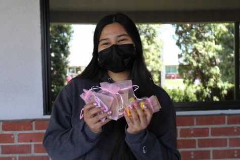 "HARDWORK: Sophomore Alondra Martinez is pictured with the products she sells in her small business. Martinez sells unique, handmade earrings that aren't seen at mainstream chain stores. For example, Martinez is pictured holding some of her SpongeBob SquarePants earrings. ""I want people to know that showing who you truly are in your outfit [and] accessories is a good way to be unique to yourself,"" Martinez said."