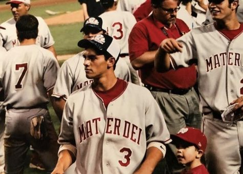 "A FAMILY AFFAIR: 2 year old Cade O'Hara stands next to half-brother, 18 year old Michael Torres after the 2005 Mater Dei baseball team wins the CIF Championship. 16 years on, O'Hara now wears that same uniform, representing Mater Dei. Torres has continued to be both his coach and role model. ""He has developed the player that I am today and the game that I play today,"" O'Hara said. ""And as a person, I've always watched him when we were out in public. I've watched how he's treated other people. He's always been super nice and caring."""