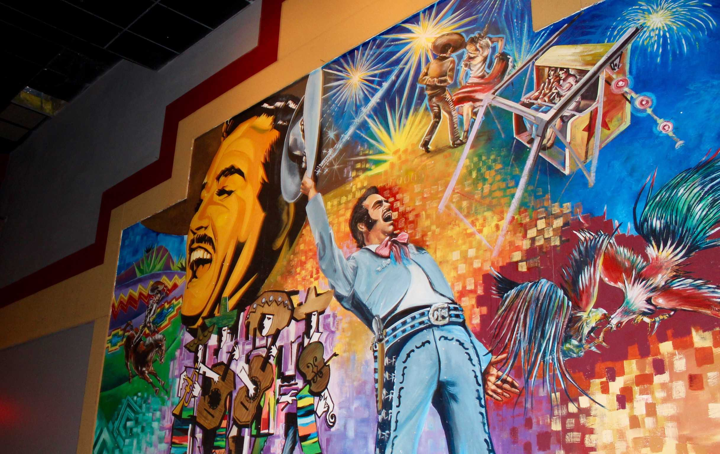 Inside+both+of+the+screening+rooms+are+vibrant+and+colorful+paintings.+In+this+room+is+a+painting+of+a+bullfighter+and+flamenco+dancer.