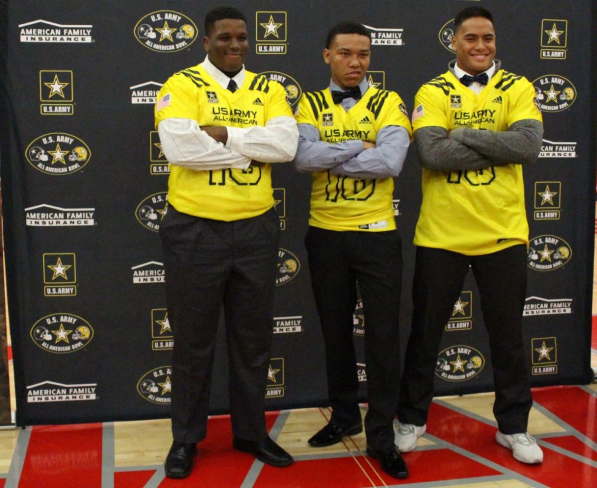Seniors+Chris+Murray%2C+Amon-Ra+St.+Brown%2C+and+Solomon+Tuliaupupu+pose+in+their+jerseys+for+the+2018+U.S.+Army-All+American+Bowl.+