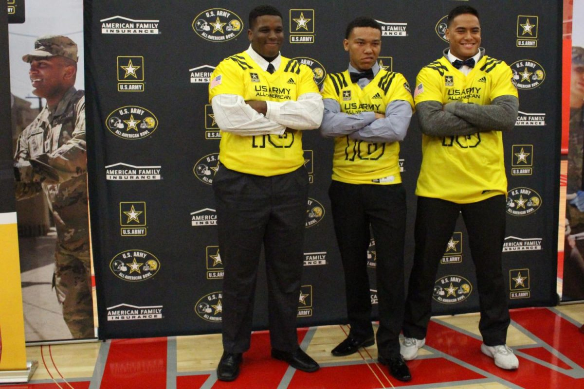 Seniors Chris Murray p, Amon-Ra St. Brown, and Solomon Tuliaupupu pose in their jerseys for the 2018 U.S. Army All American Bowl.