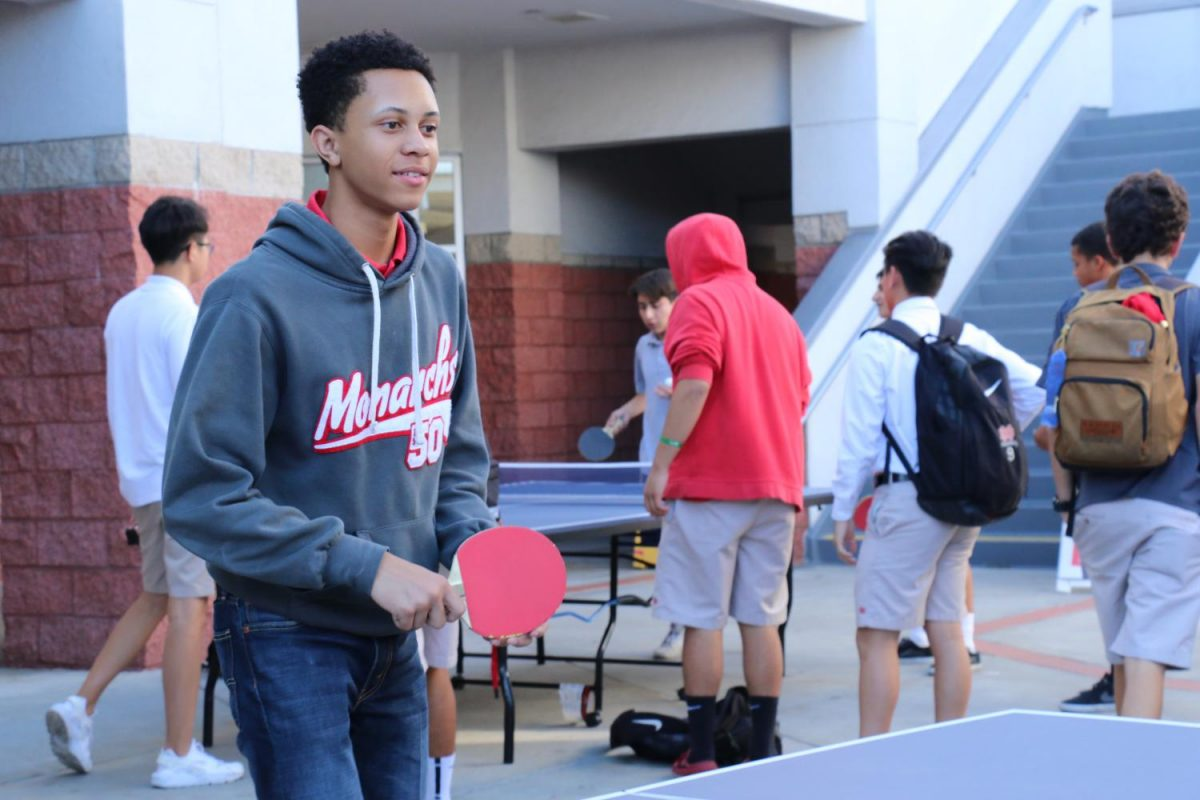 Senior Jag Jennings enjoys his first ping pong game of the year. Many members were in attendance either watching or playing.