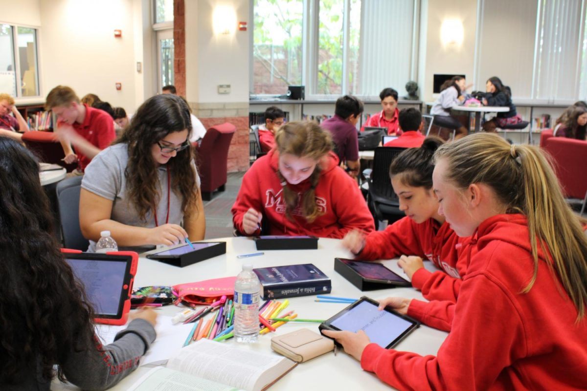 CIRCLE OF FRIENDS: Freshmen Jennie Gieco, Alyssa Walters, Shannon Macaulay, Emily Obel and Samantha Gonzalez spend office hour studying and doing homework in the the library with the help of their friends.