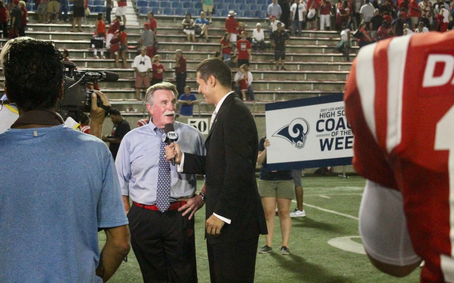Coach Bruce Rollinson gets interviewed by Fox Sports West Anchor Chris Rix after being awarded