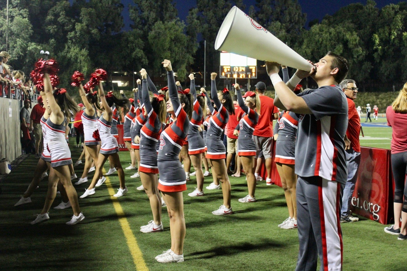 The Cheer Squad pumps up the crowd to celebrate the Monarch victory.