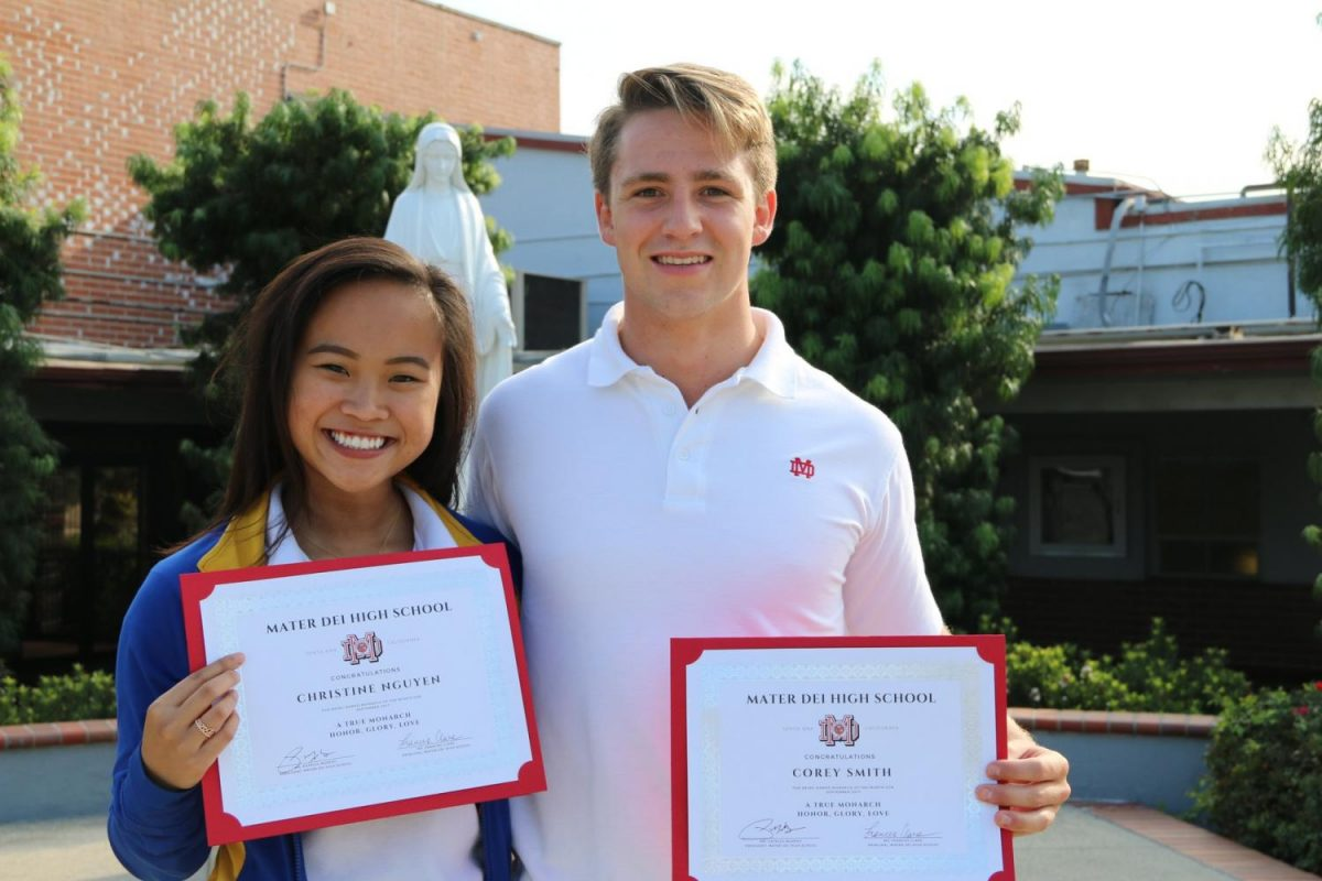 Seniors Christine Nguyen and Corey Smith pose with their 'Monarch of the Month' certificate.