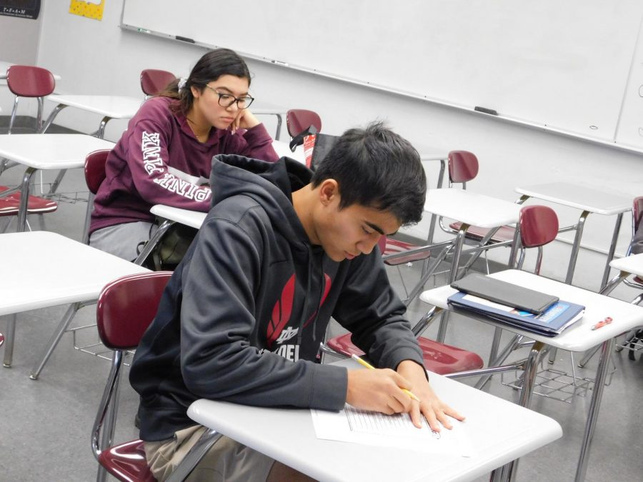 Seniors Jordan Cabrera and Brianna Acevedo take a spelling test in their English class. Spelling is an important aspect going into their English final. Any previous material on past tests can show up on finals