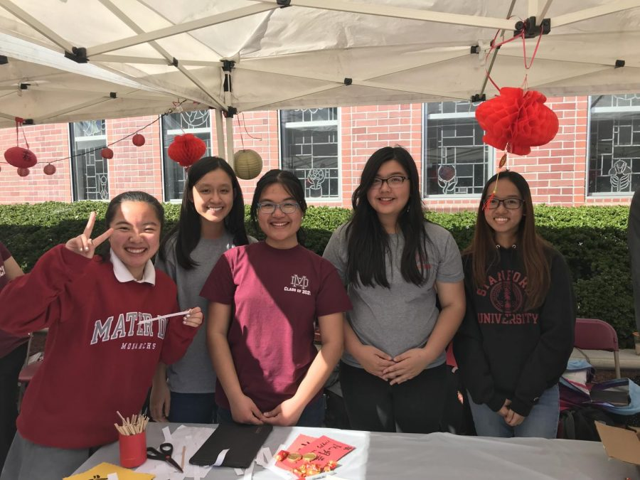 HAPPY NEW YEAR: Freshman Eva He, junior Uyen Huynh, sophomore Anh Vu, junior Vy Mai and senior An Vu (left to right) are pictured running the calligraphy booth during the celebrations in Shamrock Plaza.