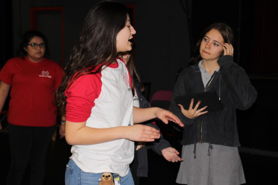 Giron guides junior Daniella Arcila during a rehearsal.