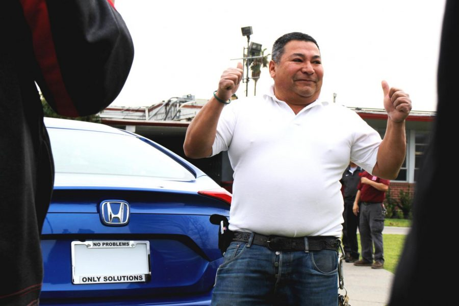 NO PROBLEMS ONLY SOLUTIONS: Bautista is presented with his new 2018 Honda Civic featuring a license frame displaying his famous motto,