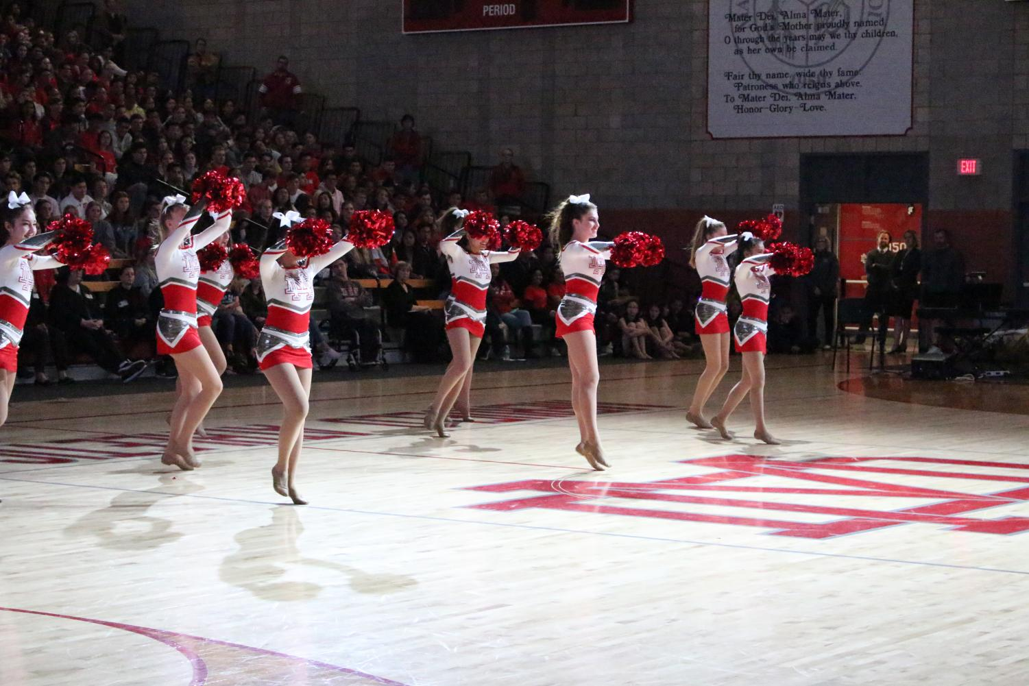 The+cheer+team+performs+at+the+Performing+Arts+Showcase+in+the+Meruelo+Athletic+Center+on+February+22%2C2018.+The+Performing+Arts+Showcase+recognizes+the+various+students+participating+in+performing+arts%2C+including+the+pep+squad%2C+the+improv+team%2C+choir%2C+All-Male+Hip-Hop%2C+the+dance+team%2C+instrumental+performance+groups+and+theatre.