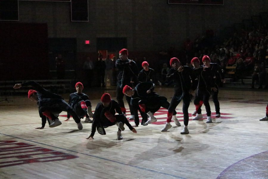 The all-male hip-hop team performs.