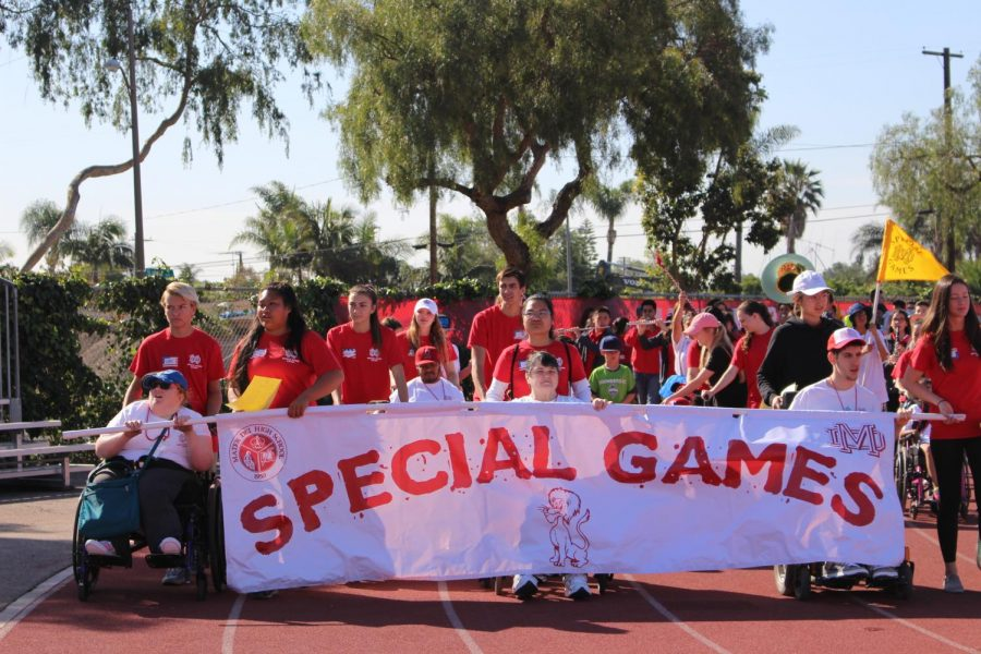 Mater Dei's Special Games began with a lap around the track. Students, athletes, volunteers and therapy dogs parade around the field until reaching the finish line. This signifies the start of a very special day.