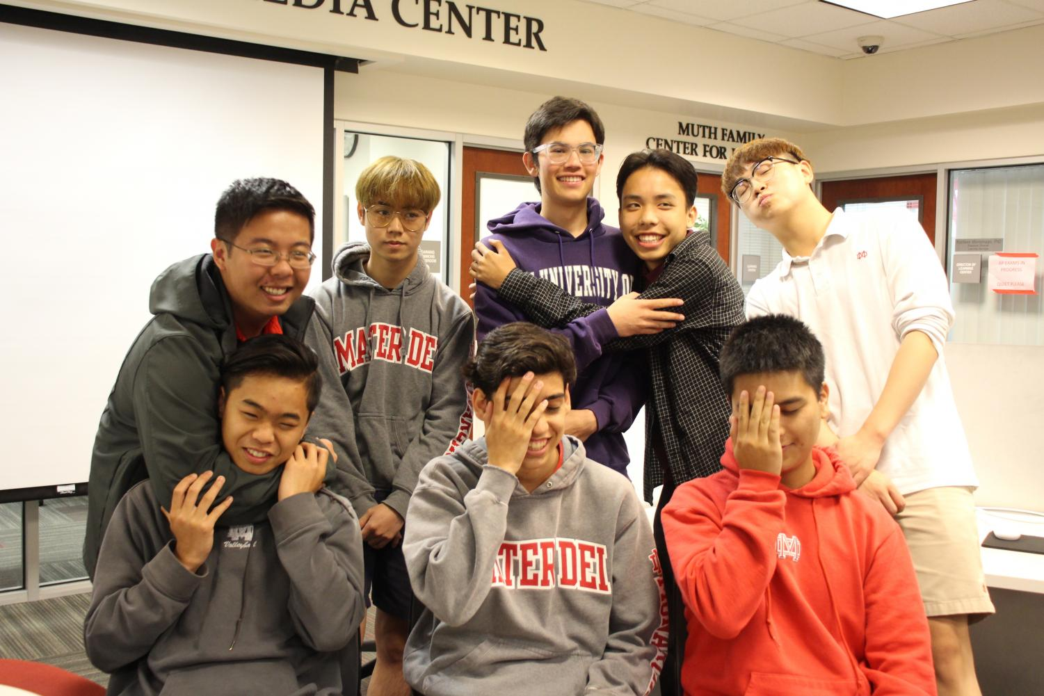 Wednesdays are for the Boys: From left to right, senior Tim Tian, junior Zipeng (Lester) Zhao, junior Nathan Cole, junior team captain Aiden Nguyen, senior Yunqi (Murphy) Chu, junior Travis Tran, junior Dylan Ebuhardt and junior Matthew Vu pose for a photo.