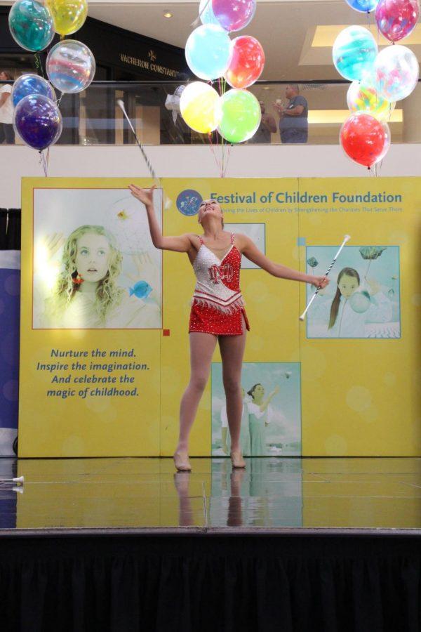 TWIRLING TALENT: Junior Cameron Doan juggles three batons as she twirls them in the air.