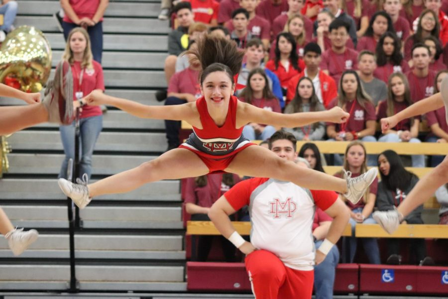 CHEERLEAPING: Freshman Nicole Gonzalez performs with the cheer squad during their unity dance with the song team at the rally.
